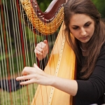 World Fiddle Ensemble with YAHS alumni Liana Alpino.